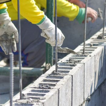 Photo of a Bricklayer working on a block fence in Ascot, Brisbane