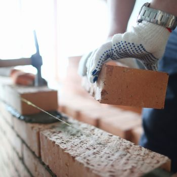 Photo of a bricklaying laying a retaining wall New Farm, Brisbane